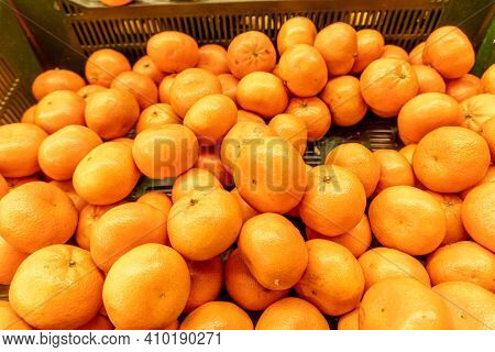 Fresh Tangerines In The Store Close-up. Crates Full Of Ripe Mandarin And Clementines Oranges For Sal