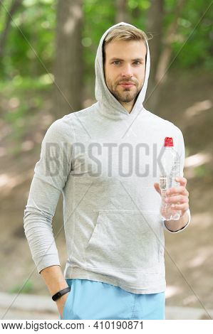 Refreshing Vitamin Drink After Great Workout. Man Athletic Appearance Holds Water Bottle. Athlete Dr