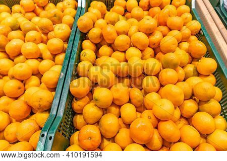 Fresh Oranges, Tangerines And Clementines As Food Background Or Texture. Assorted Citrus On The Mark