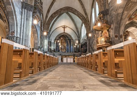 Chur, Switzerland - February 19, 2021: Interior Of The Catholic Cathedral In Chur, The Oldest Town I