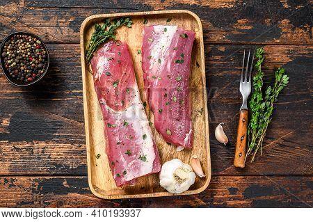 Marinated Pork Tenderloin Meat Steak With Thyme. Dark Wooden Background. Top View