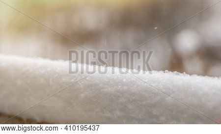 A Thick Layer Of Snow On The Background Of Trees. Winter Holidays Background With Snow Texture. Laye