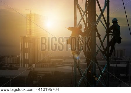 Silhouette Workers On Background Construction Crews To Work On High Ground Heavy Industry And Safety