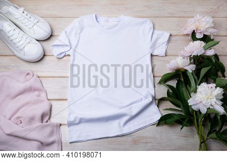Women's T-shirt Mockup With White Sneakers And Peonies