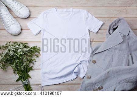 Women's T-shirt Mockup With Wild Grass And Linen Jacket