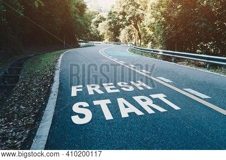 Fresh Start On Road Lane In Wood  Represents The Beginning Of A Journey To The Destination In Busine