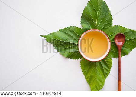 Mulberry Tea With Leaves Mulberry In Cup On White Wooden. Hot Tea From Nature For Health. Drink Of T