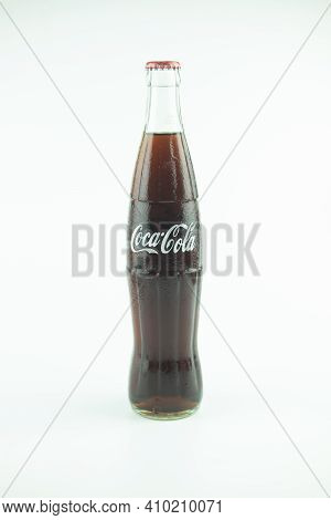 Samut Prakan, Thailand - February 28, 2021 : Coca Cola Bottle Unopened Soft Drinks. Coke Famous Beve