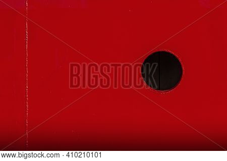 Red Metal Gradient Background With Black Circle Porthole.  Empty Place For Text, Copy Space.
