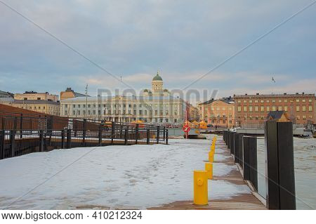 Finland, Helsinki February 26, 2021 View Of The Embankment In Helsinki, Thaw, Reflected In The Water