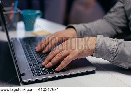 Hands Of Office Manager Over Keypad In Corporate Workplace. Close Up Of Male Hands Typing On Laptop