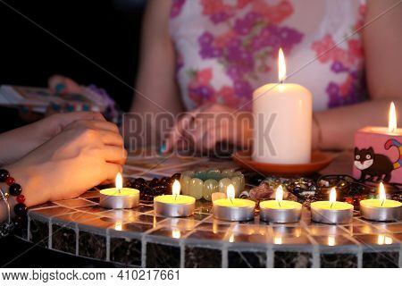 Fortune Telling Session, Seeing The Destiny And Astrology. Female Hands With Tarot Cards, Candles On