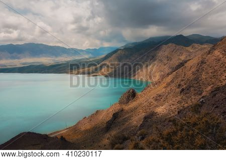 Bartogay Reservoir On The Chilik River Surrounded By The Tien Shan Mountains In The Almaty Region