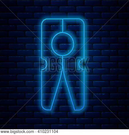 Glowing Neon Line Old Wood Clothes Pin Icon Isolated On Brick Wall Background. Clothes Peg. Vector