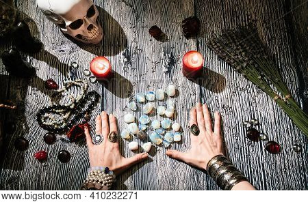 Fortunetellers Hands With Stone Runes, Top View. Prediction Of The Future. Mystic Interior.