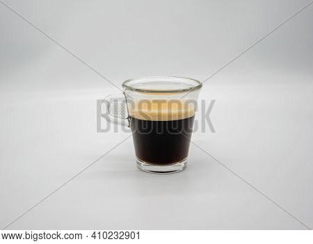 Close Up Of A Glass Of Espresso Isolated On White Background