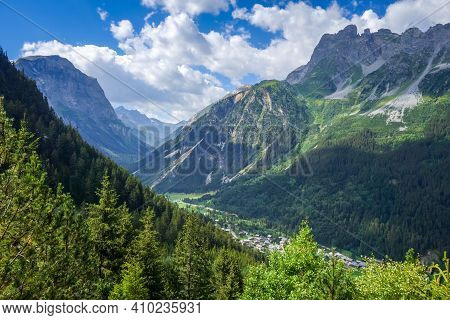 Pralognan La Vanoise Town And Mountains Landscape. French Alps