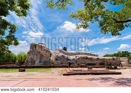 Ayutthaya, Thailand - June 15, 2019: Ancient Reclining Buddha Image In Wat Lokaya Suttharam, The Tra