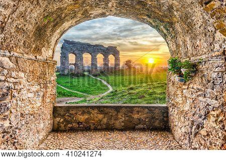 Scenic Rock Arch Balcony Overlooking The Iconic Ruins Of Parco Degli Acquedotti, Rome, Italy