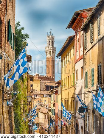 Walking In The Picturesque Streets In The Medieval City Centre Of Siena, One Of The Nation's Most Vi