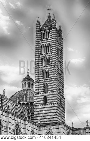 Belltower Of The Gothic Cathedral Of Siena, Tuscany, Italy. Completed In 1348, The Church Is Dedicat
