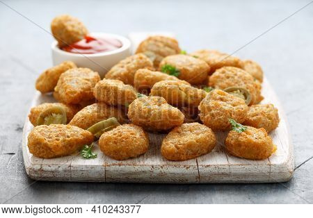 Crispy Jalapeno Popper With Creamy Cheese Battered On White Wooden Board