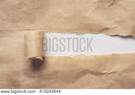 Brown Paper Torn To Reveal White Panel For Text With Copy Space