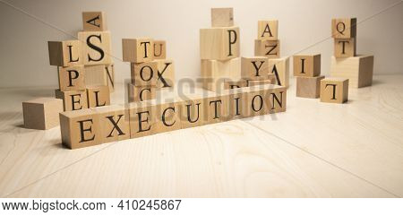 The Word Execution Is From Wooden Cubes. Economy State Government Terms.