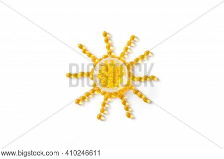 Vitamin D3 Capsules (softgels) In Shape Of Sun. Yellow Oil Softgels Isolated On White, Top View, Cop