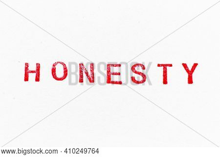Red Color Ink Rubber Stamp In Word Honesty On White Paper Background