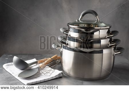 Set Of Various Cookware And Utensils On Dark Background. Recipe Book, Cooking Classes Concept. Space