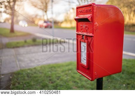 Swansea, Wales, Uk - February 25, 2021: Traditional British Red Royal Mail Mailbox For Letters In A