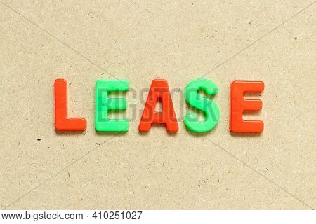 Color Alphabet Letter With Word Lease On Wood Background