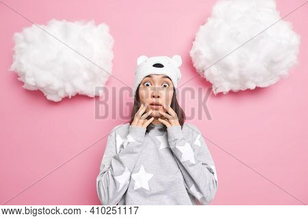 Concerned Scared Brunette Young Asian Woman Stares At Camera Witnesses Terrible Scene Wears Sleepwea