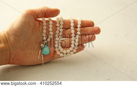 Rosary Mala 108 Beads From Natural Stones Moonstone Lie In Girl's Hand. Author's Jewelry From Natura