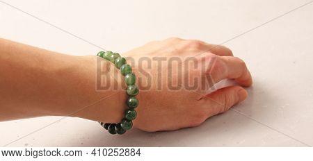 Nephritis Bracelet. Bracelet Made Of Stones On Hand From Natural Stone Nephritis. Bracelet Made Of N