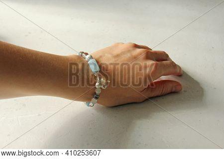 Asymmetric Aquamarine Bracelet. A Bracelet Made Of Stones On A Hand From A Natural Stone Aquamarine.