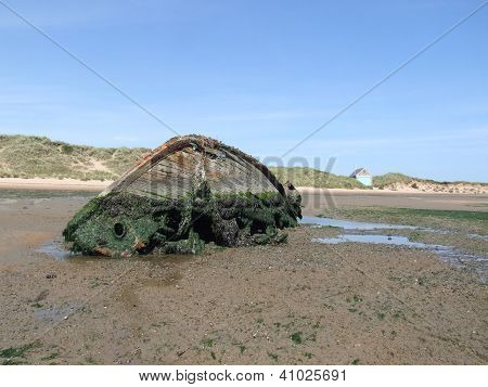 Wrecked boat on the beach.
