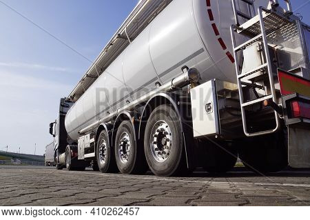 A Truck During A Break, A Tanker In The Foreground. Truck Stop Next To The Highway.