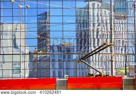 The Facade Of A Modern Building. Reflection In The Facade Of Another Building.