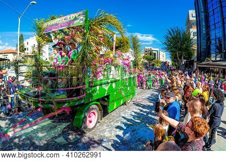 Limassol, Cyprus - March 01, 2020: Carriage With A Group Of Participants In Colorful Costumes During