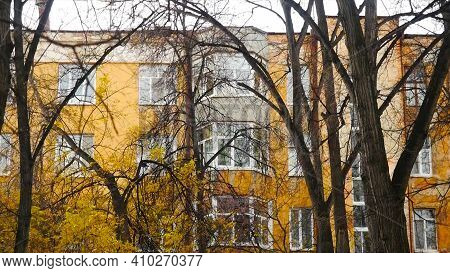 Exterior Of Residential Building In Autumn. Stock Footage. Ordinary Residential Building With Beauti