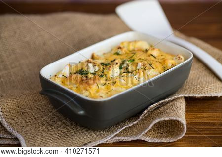 Baked Cauliflower With Chicken Fillet And Vegetables Topped With Cheese