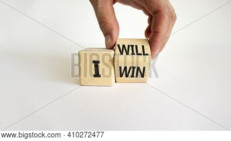 I Will Win Symbol. Businessman Turns Cubes And Changes Words I Will To I Win. Beautiful White Backgr
