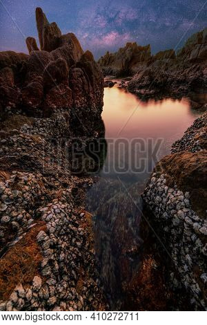 Seascape During Sunset Or Sunrise Light Of Nature. Amazing Natural Seascape With Rocks In The Foregr