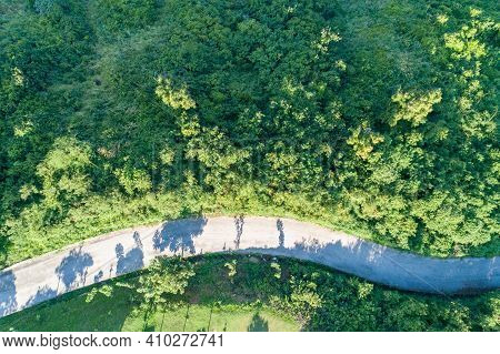 Aerial View Top View Asphalt Road Curve In The Green Forest.