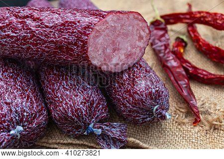 Homemade Sausage Cervelat On Wooden Background, Chili Pepper