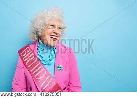 Horizontal Shot Of Happy Old Woman Celebrates Jubilee Happy About Congratulations Dressed In Festive