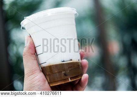 Bangkok, Thailand - February 28, 2021: Starbucks Iced Salted Caramel Cloud Macchiato. Espresso Shot