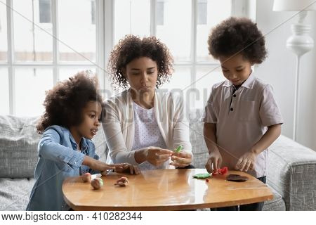 Two Black Kids And Mom Sculpting From Plasticine At Home